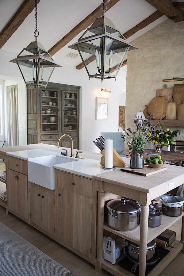 Patina Farm's stunning #modernfarmhouse kitchen with center island and hanging lanterns #whiteoak #organickitchen