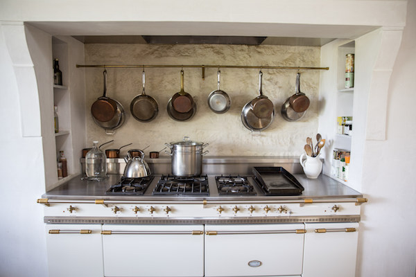 Cream Lacanche range with pot rack and limestone backsplash in #PatinaFarm modern farmhouse kitchen