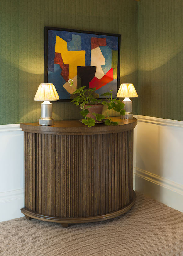 The Demi Lune Tabour Cabinet + Old Flax Bayleaf wall fabric
