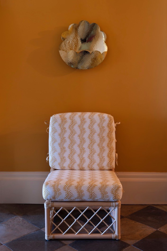 The-Scalloped-Helios-Wall-Light-and-Lily-Slipper-Chair-in-Scrolling-Fern-Fabric