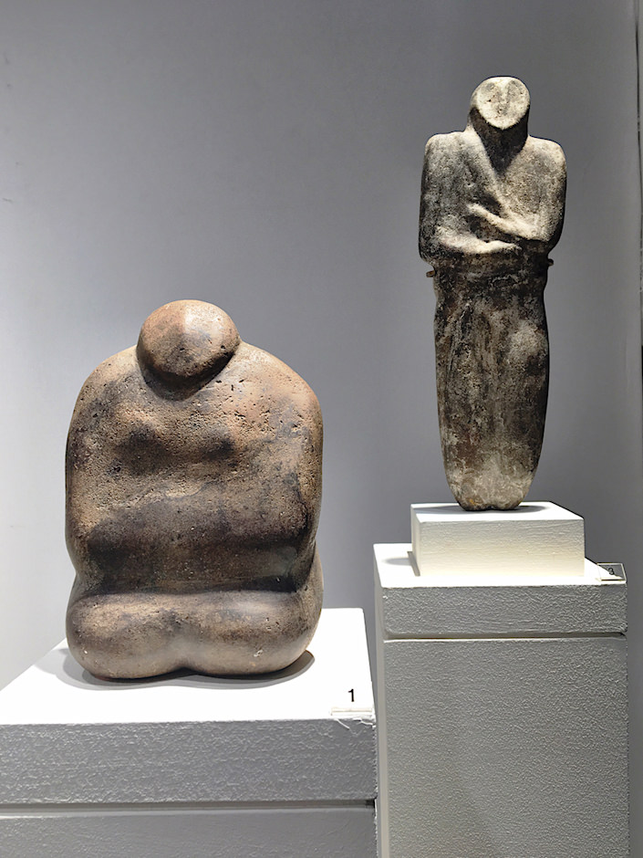Male and female stone idols from milennial BC from CAHN, Basel at TEFAF New York Spring