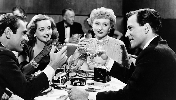 Betty Davis drinking champagne in All About Eve