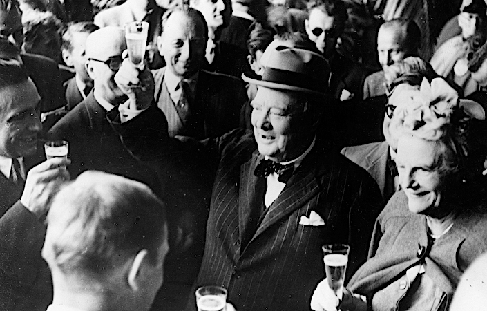 Winston Churchill toasting with champagne