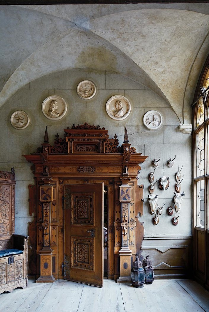 Schloss Hollenegg in Austria with 17th c. door and faux stone plaster, photo Simon Watson for T magazine