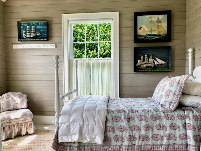 Nantucket guest house bedroom with ship dioramas