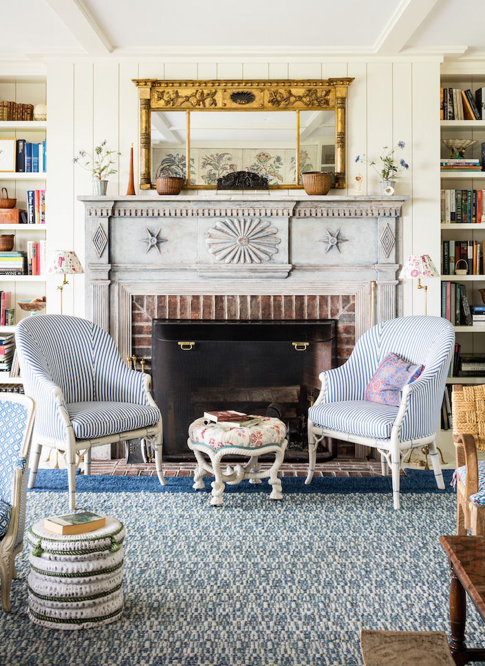 Markham Roberts Nantucket designs a fireplace for the living room via Quintessence