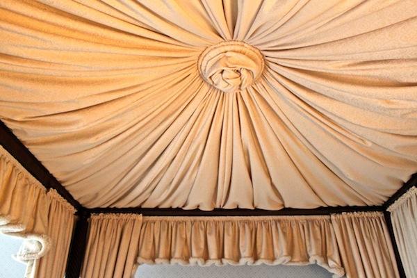 Inside of canopy bed at Mayflower Inn