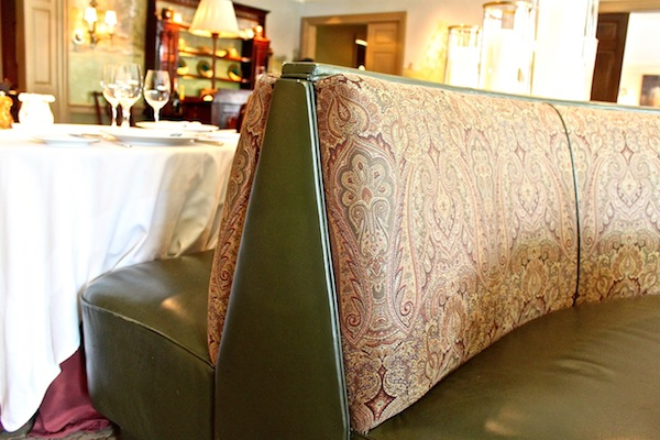 Green leather and paisley banquettes